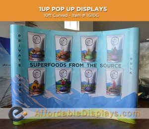 10ft curved pop up displays for trade shows includes custom graphic panels and wheeled shipping cases