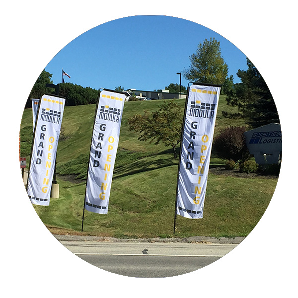 Modula grand opening sail flags by Affordable Displays